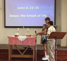 putting bread on altar