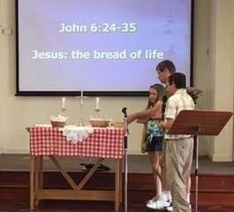putting bread on altar
