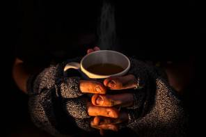 Homeless man with a hot steaming cup of tea